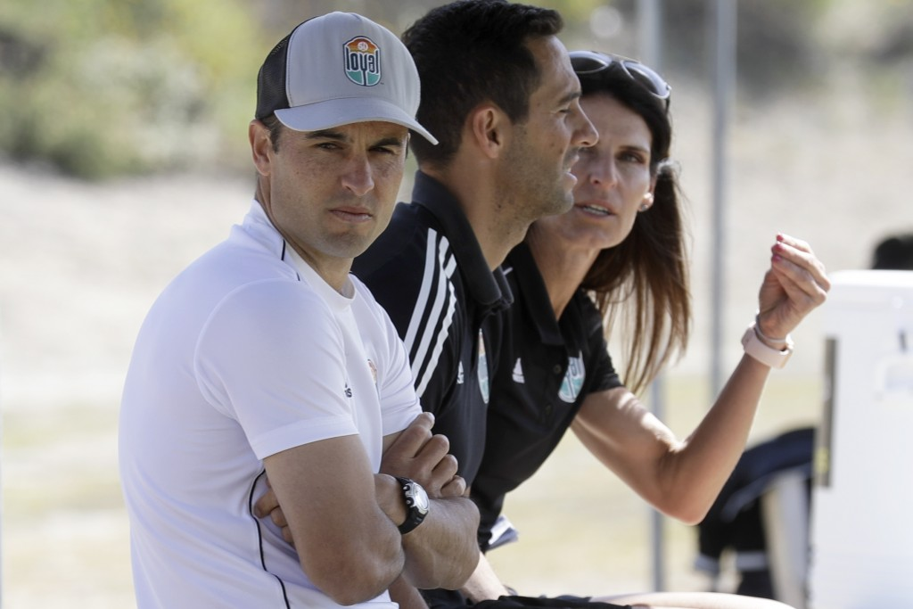 Landon Donovan, left, looks on alongside assistant coaches Nate Miller, center, and Carrie Taylor, right, during a scrimmage, Wednesday, March 4, 2020...