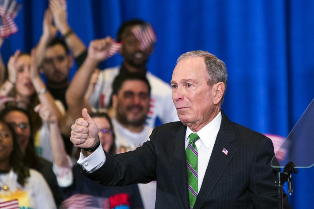 Former Democratic presidential candidate Mike Bloomberg gestures to supporters as he announces the suspension of his campaign and his endorsement of f...