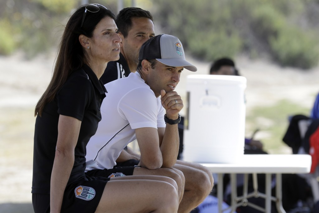 Landon Donovan, right, looks on alongside assistant coaches Nate Miller, center, and Carrie Taylor, left, during a scrimmage Wednesday, March 4, 2020 ...