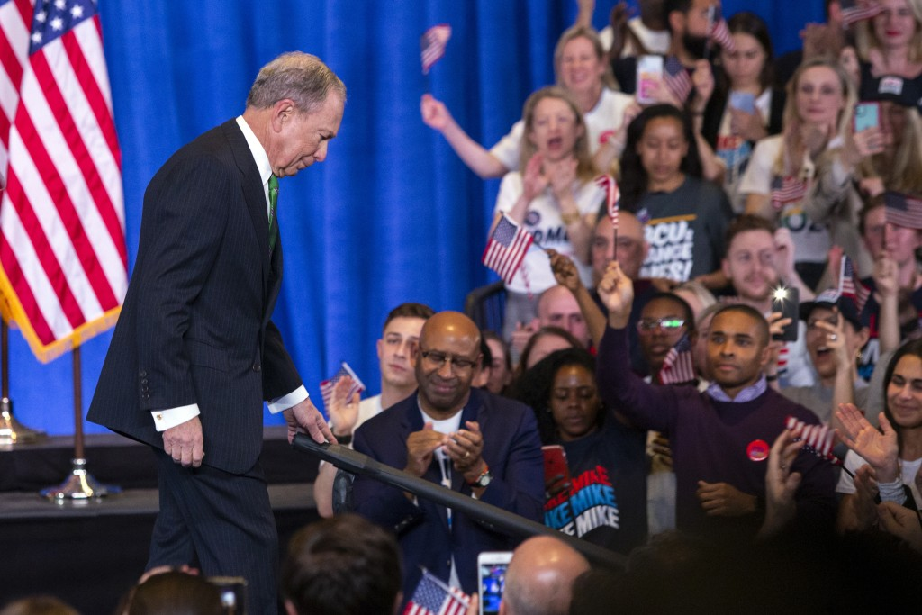 Former Democratic presidential candidate Mike Bloomberg leaves after speaking to supporters as he announces the suspension of his campaign and his end...