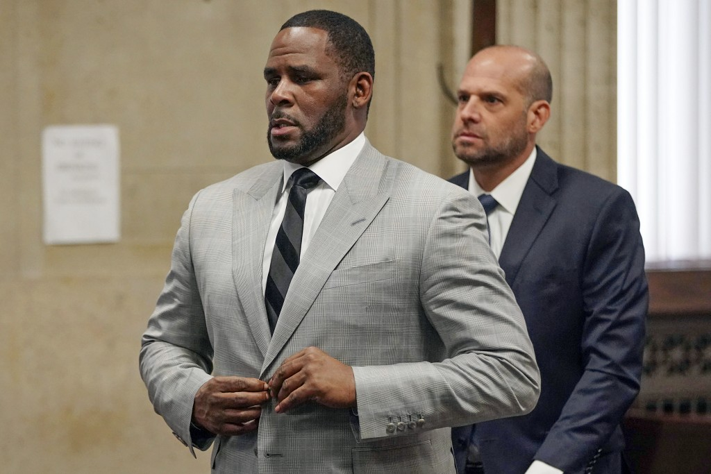 FILE - In this June 6, 2019, file photo, singer R. Kelly pleaded not guilty to 11 additional sex-related felonies during a court hearing before Judge ...