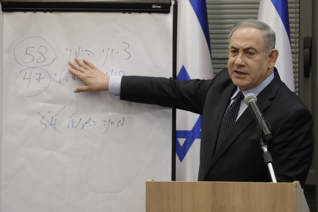 Israeli Prime Minister Benjamin Netanyahu explains some elections results during a meeting with his nationalist allies and his Likud party members at ...
