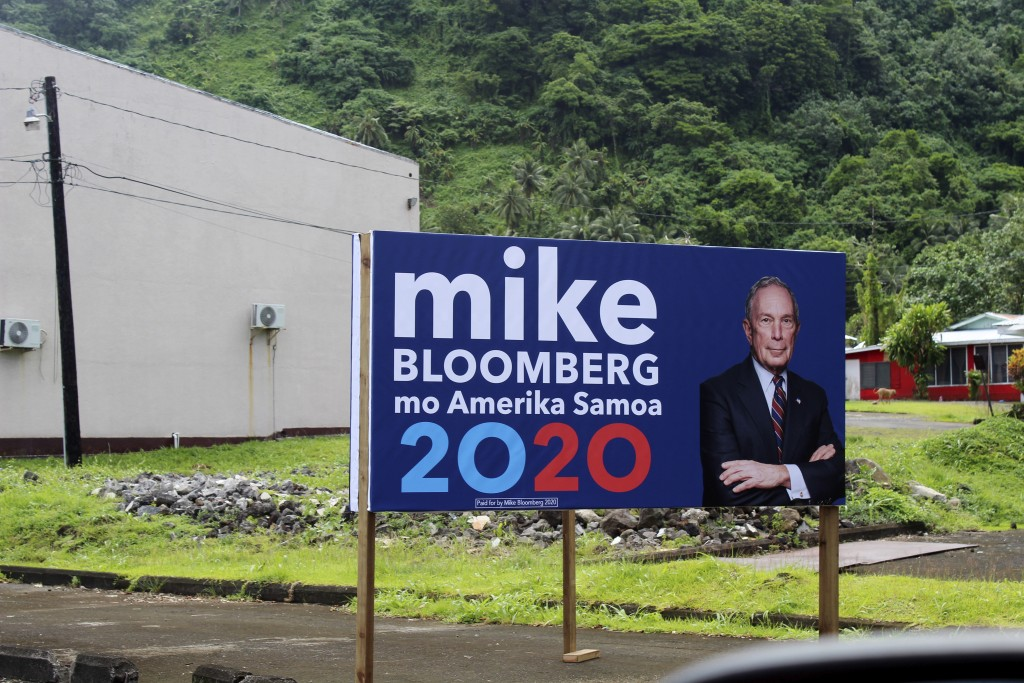 In this Feb. 27, 2020 photo, a sign for the Mike Bloomberg campaign is shown in the village of Nu'uuli, near Pago Pago, American Samoa. Mike Bloomberg...