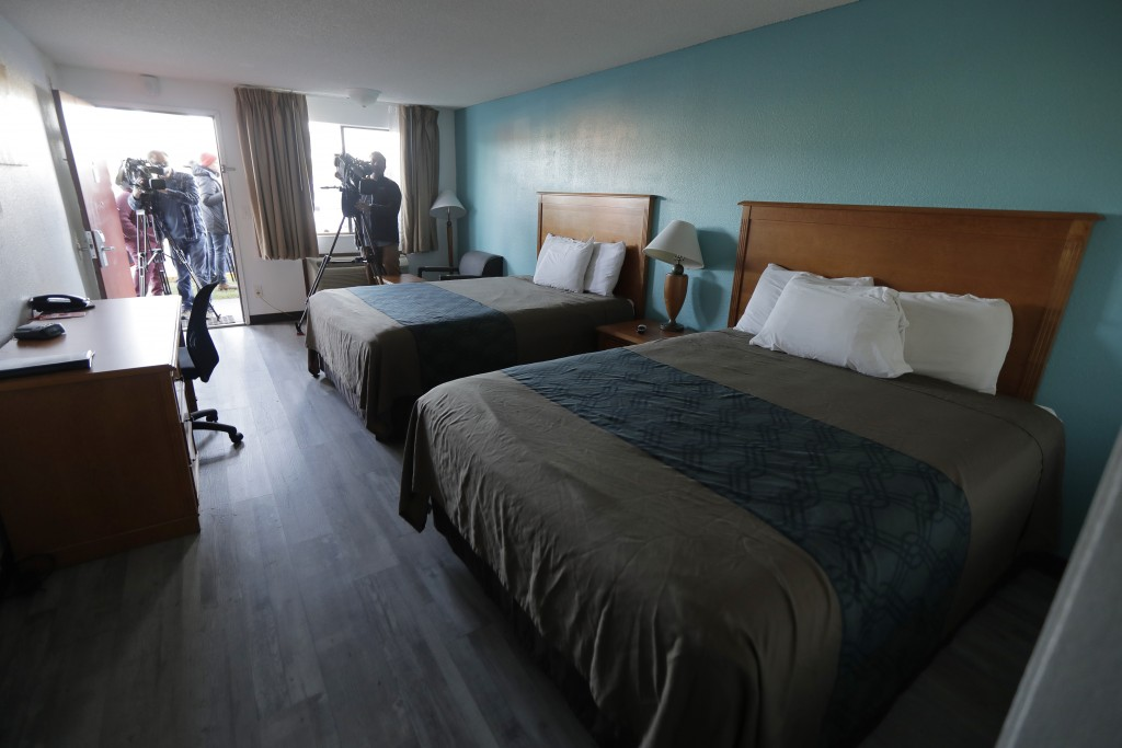 Journalists photograph a room at an Econo Lodge motel in Kent, Wash., Wednesday, March 4, 2020. King County Executive Dow Constantine said Wednesday t...