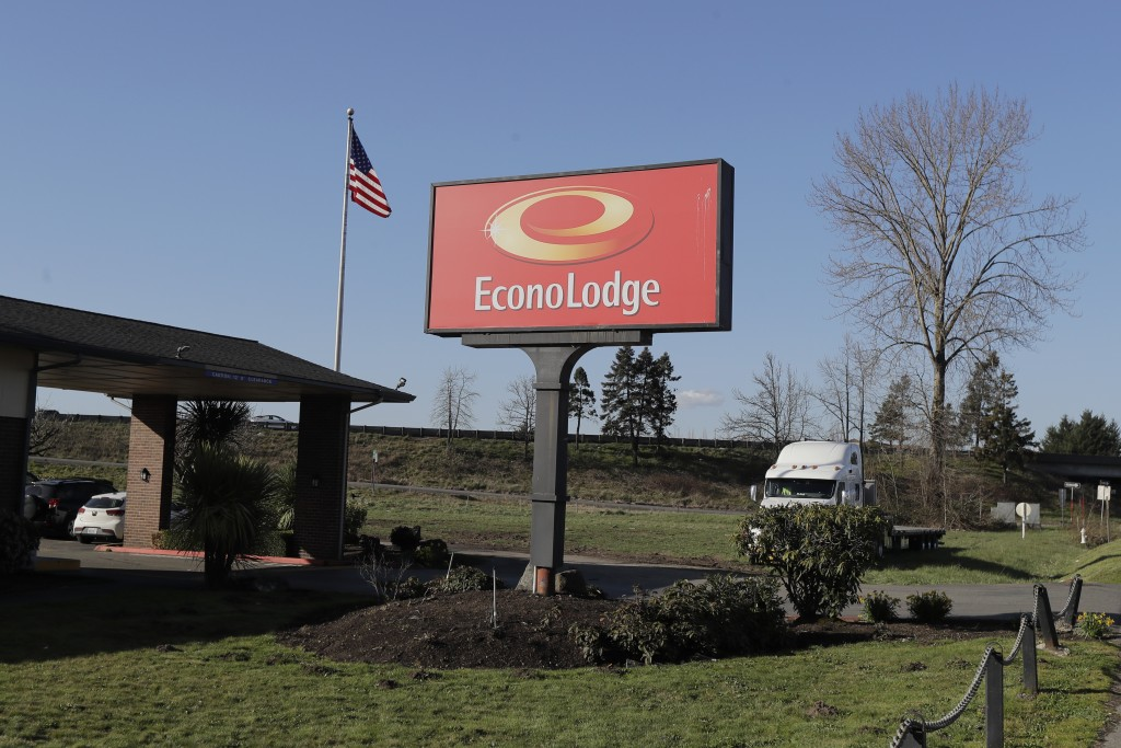 A U.S. flag flies near the entrance of an Econo Lodge motel in Kent, Wash., Wednesday, March 4, 2020. King County Executive Dow Constantine said Wedne...