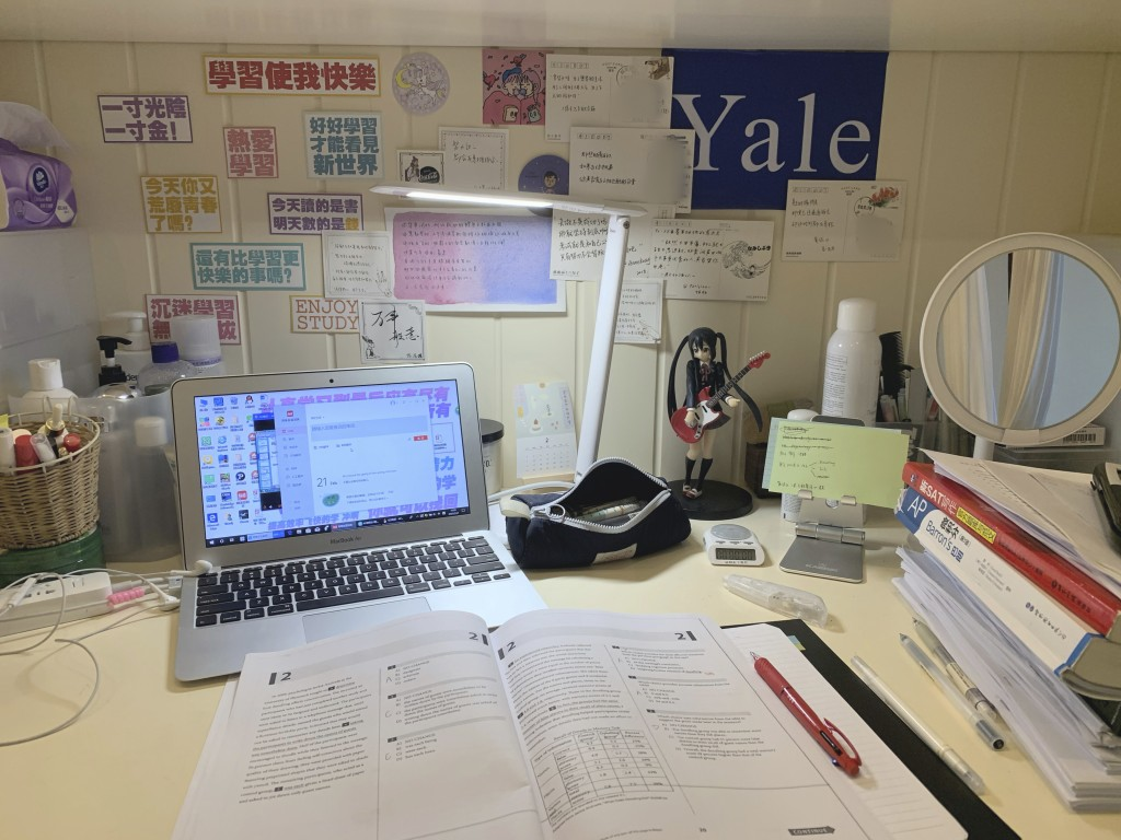 This Feb. 26, 2020 photo released by Tan Weiwei, shows a view of the 17-year-old's desk in Changsha, in southern China's Hunan province. She spent her...