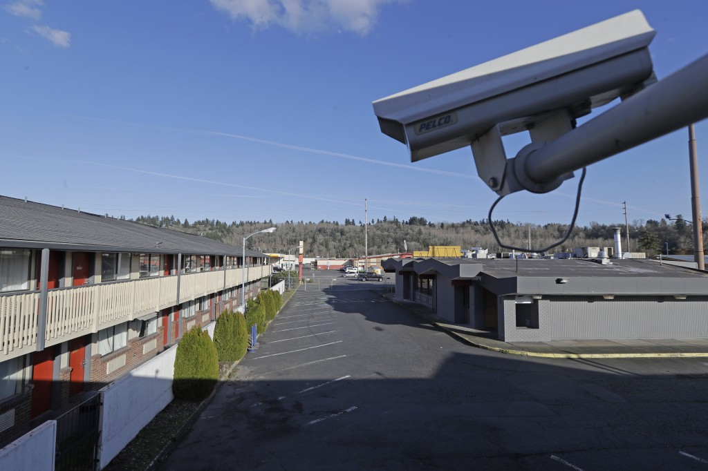 A security camera is shown on the second floor of a row of rooms at an Econo Lodge motel in Kent, Wash., Wednesday, March 4, 2020. King County Executi...