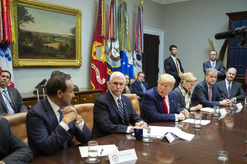 President Donald Trump with, from left, United Airlines CEO Oscar Munos, Vice President Mike Pence, Trump, White House coronavirus response coordinato...