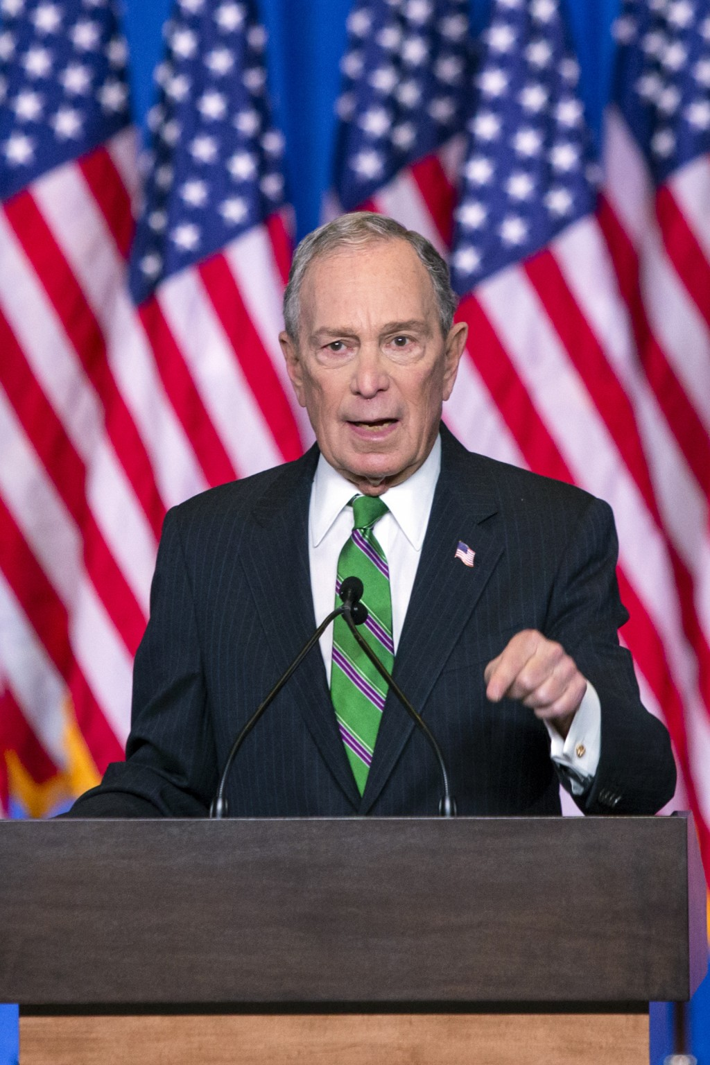 Former Democratic presidential candidate Mike Bloomberg waves to supporters as he announces the suspension of his campaign and his endorsement of form...