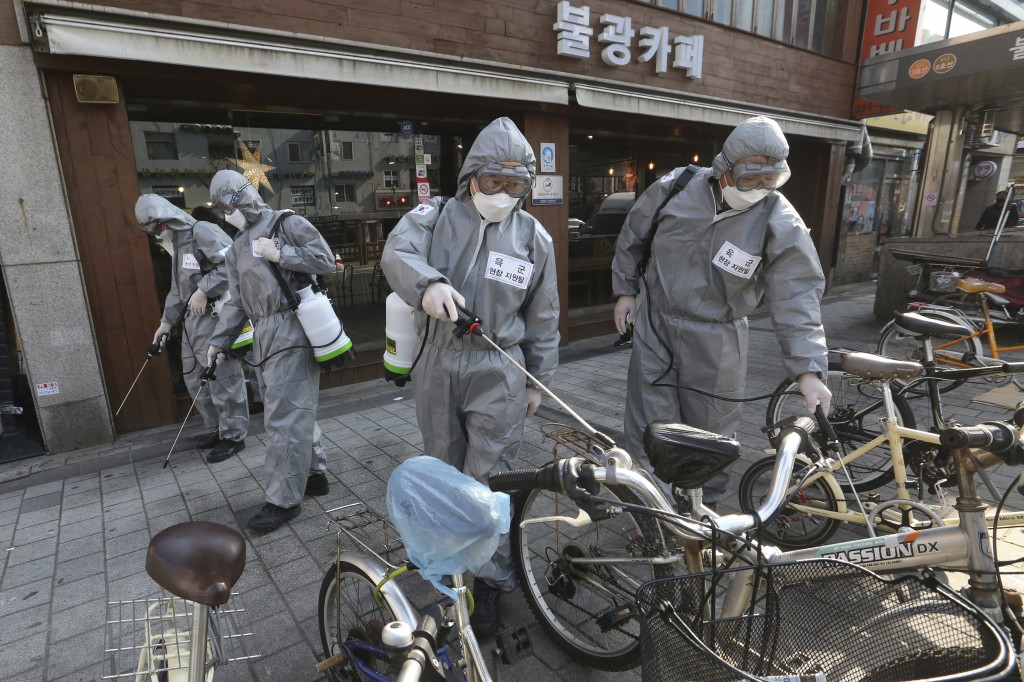 South Korean army soldiers spray disinfectant as a precaution against the new coronavirus on a street in Seoul, South Korea, Friday, March 6, 2020. So...