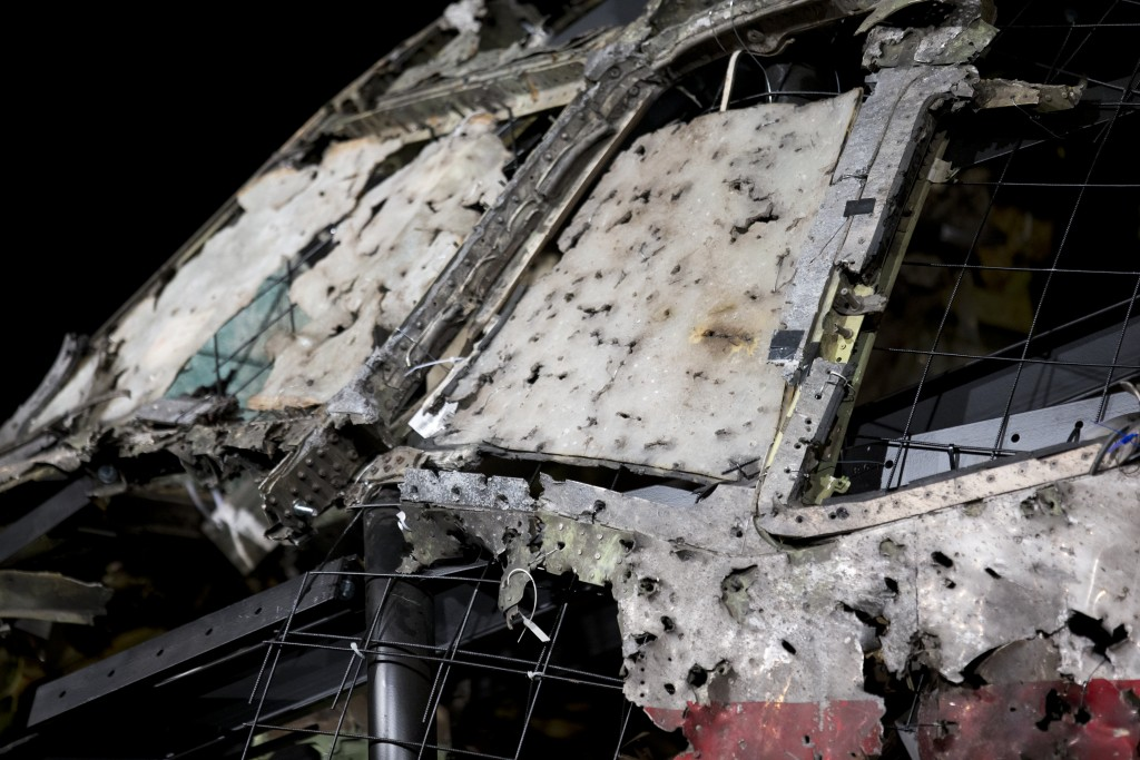 FIlE - In this Tuesday, Oct. 13, 2015, file image, the reconstructed cockpit of Malaysia Airlines Flight MH17 plane is displayed before a news confere...