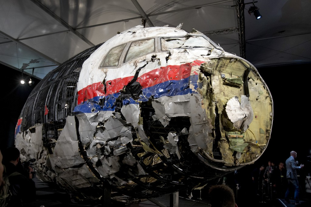 FILE - This Tuesday, Oct. 13, 2015 file photo, shows the reconstructed wreckage of Malaysia Airlines Flight MH17, put on display during a press confer...
