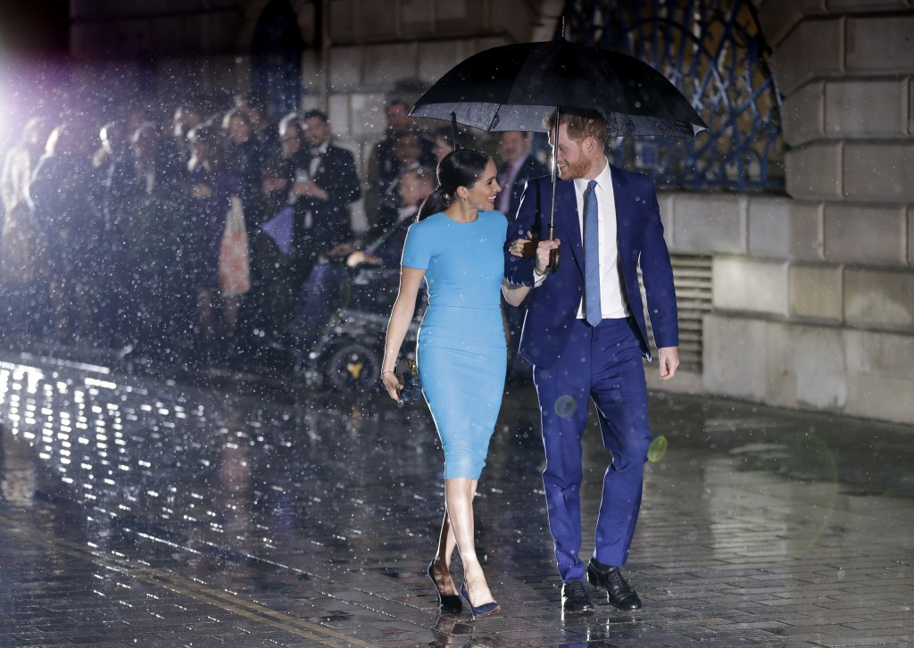 Britain's Prince Harry and Meghan, the Duke and Duchess of Sussex arrive at the annual Endeavour Fund Awards in London, Thursday, March 5, 2020. The a...