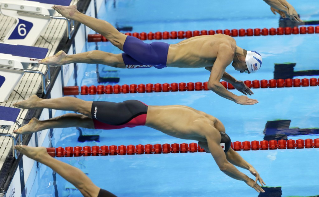 FILE - In this Wednesday, Aug. 10, 2016 file photo, United States' Michael Phelps, top, and Japan's Hiromasa Fujimori compete in a heat of the men's 2...