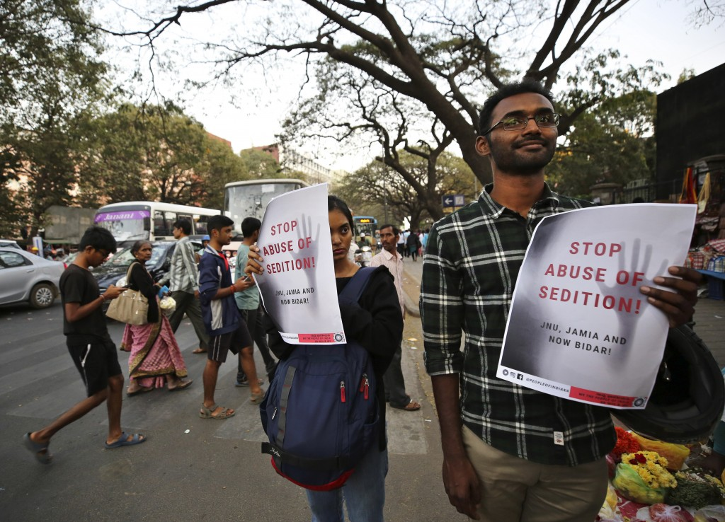 In this Tuesday, Feb. 4, 2020 photo, Indians hold placards during a protest against the sedition case filed by police against a school after a play pr...