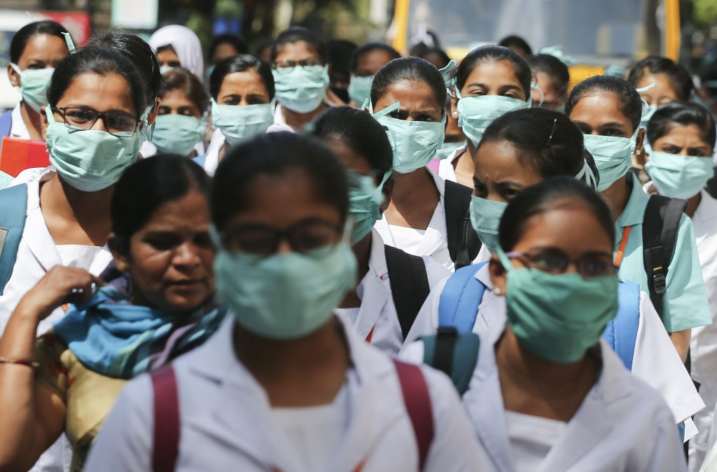 Indian nursing students wearing masks walk in a group at government run Gandhi Hospital in Hyderabad, India, Friday, March 6, 2020. For weeks India wa...
