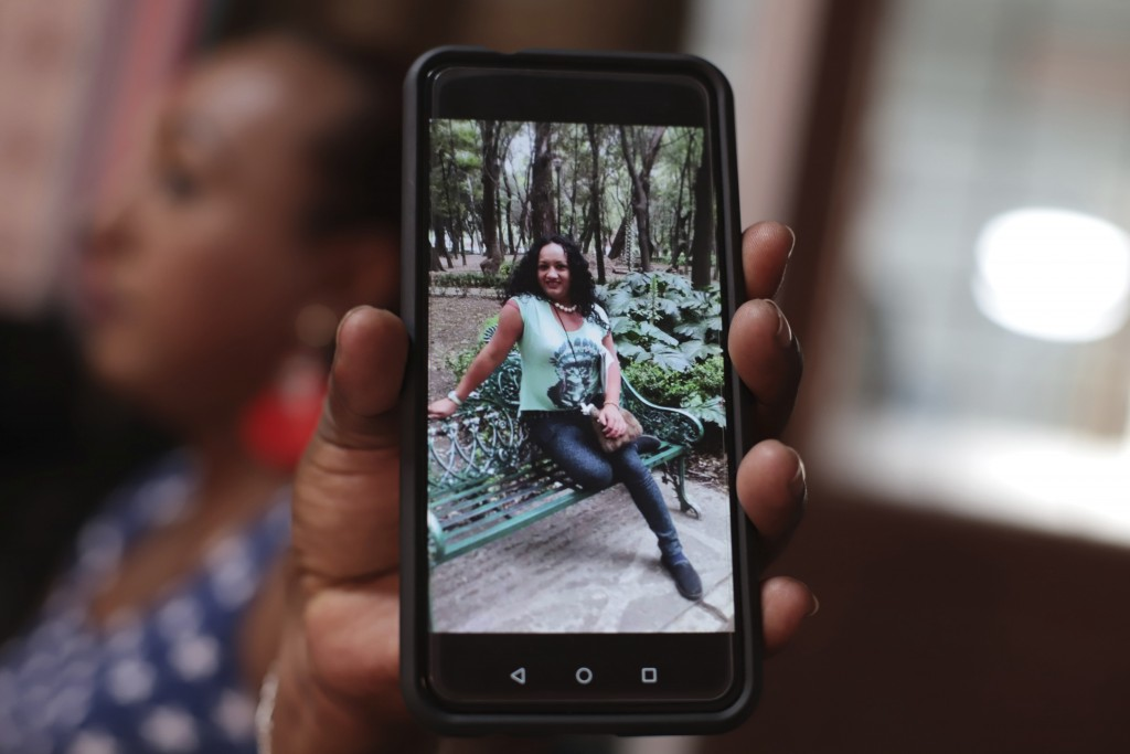 In this Feb. 12, 2020 photo, transgender woman Leticia shows a photograph of Camila Díaz, another transgender woman she met while migrating to the U.S...