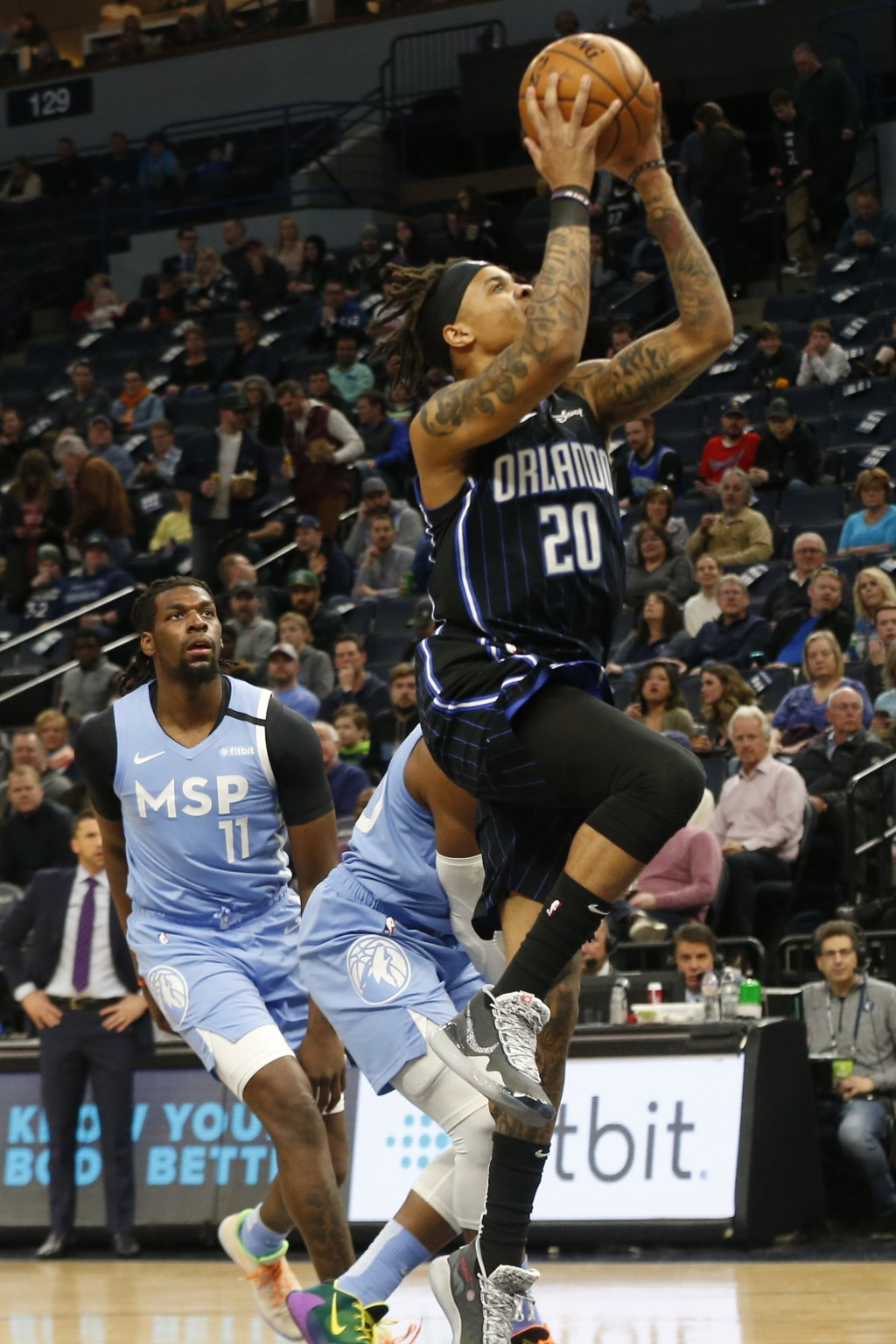 Orlando Magic's Markelle Fultz, right, lays up as Minnesota Timberwolves' D'Angelo Russell watches in the first half of an NBA basketball game, Friday...