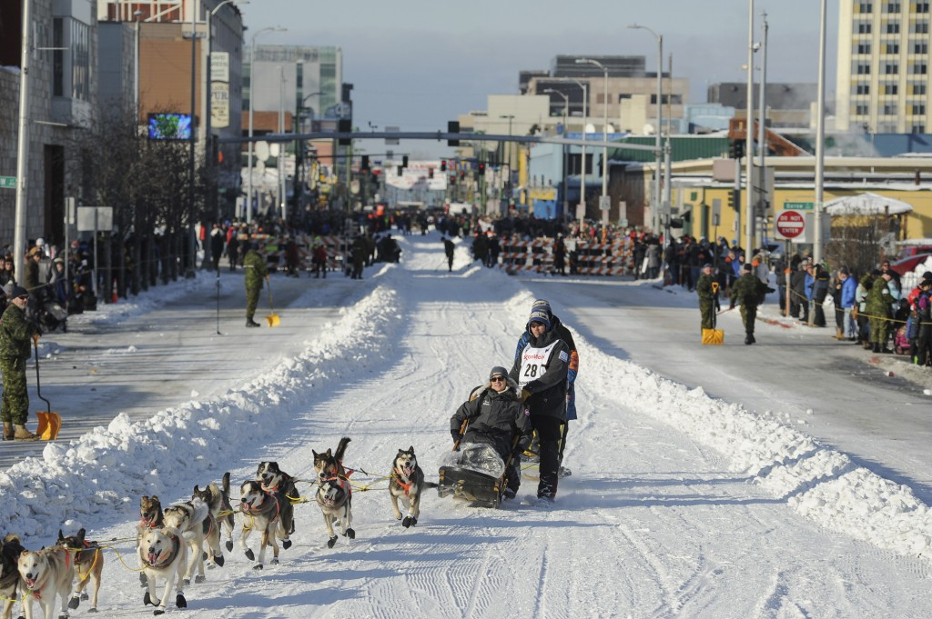 FILE - In this March 2, 2019, file photo, defending champion Joar Lefseth Ulsom runs his team down Fourth Ave during the ceremonial start of the Idita...
