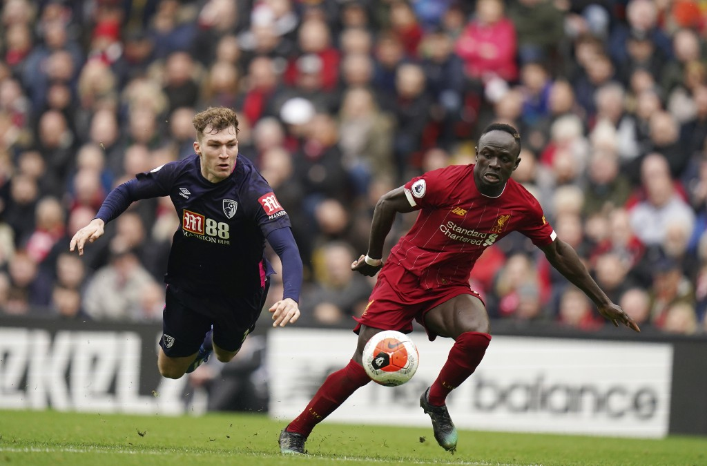 Liverpool's Sadio Mane, right, dribbles past Bournemouth's Jack Stacey during the English Premier League soccer match between Liverpool and Bournemout...