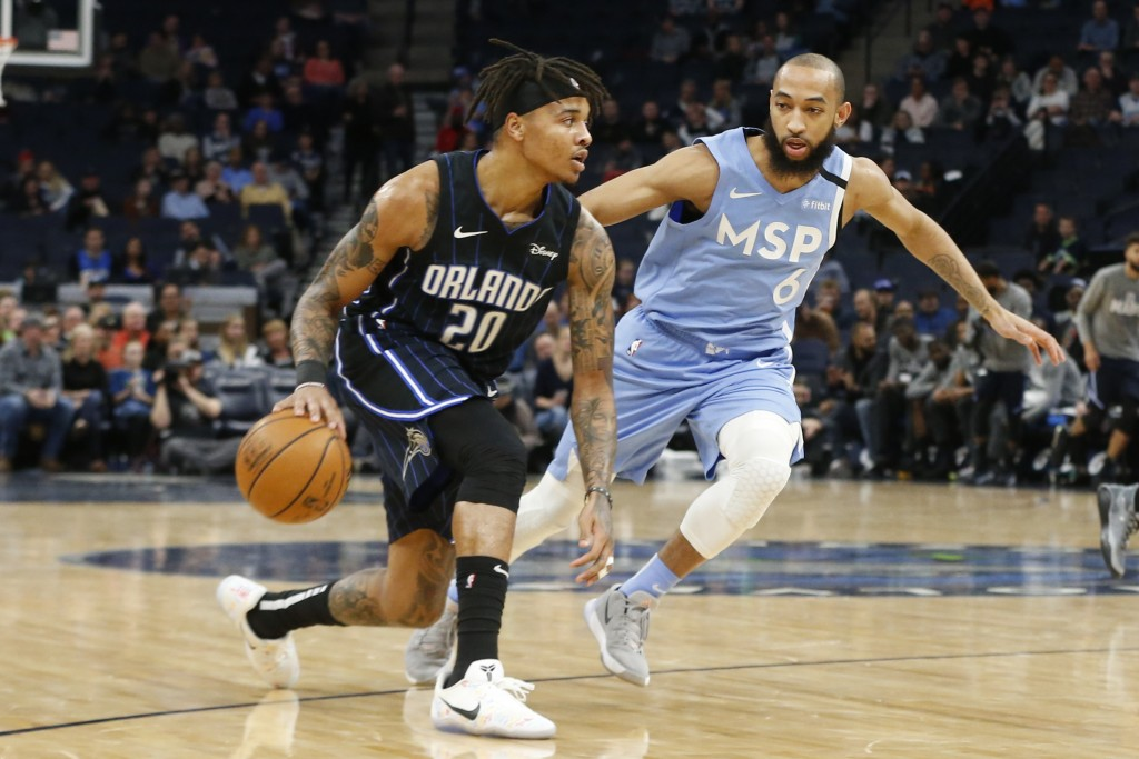 Orlando Magic's Markelle Fultz, left, drives against Minnesota Timberwolves' Jordan McLaughlin in the first half of an NBA basketball game, Friday, Ma...