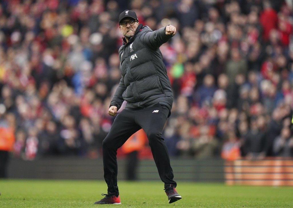 Liverpool's manager Jurgen Klopp celebrates at the end of the English Premier League soccer match between Liverpool and Bournemouth at Anfield stadium...