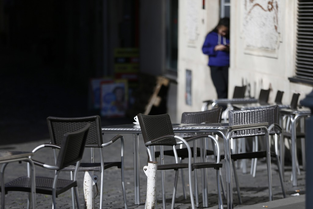 Chairs are empty at a cafe in Largo Argentina square amid growing concern about the spread of a new coronavirus in Rome Saturday, March 7, 2020. Italy...