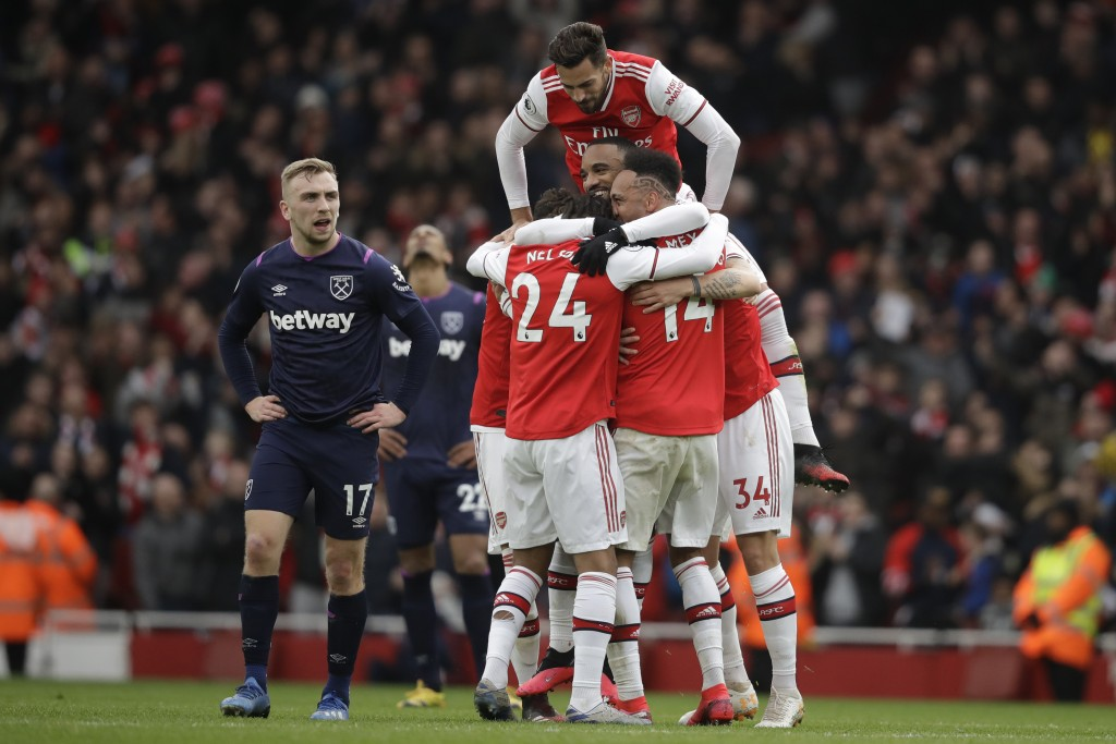 Arsenal's Alexandre Lacazette celebrates his goal after a video review with teammates during the Premier League soccer match between Arsenal and West ...