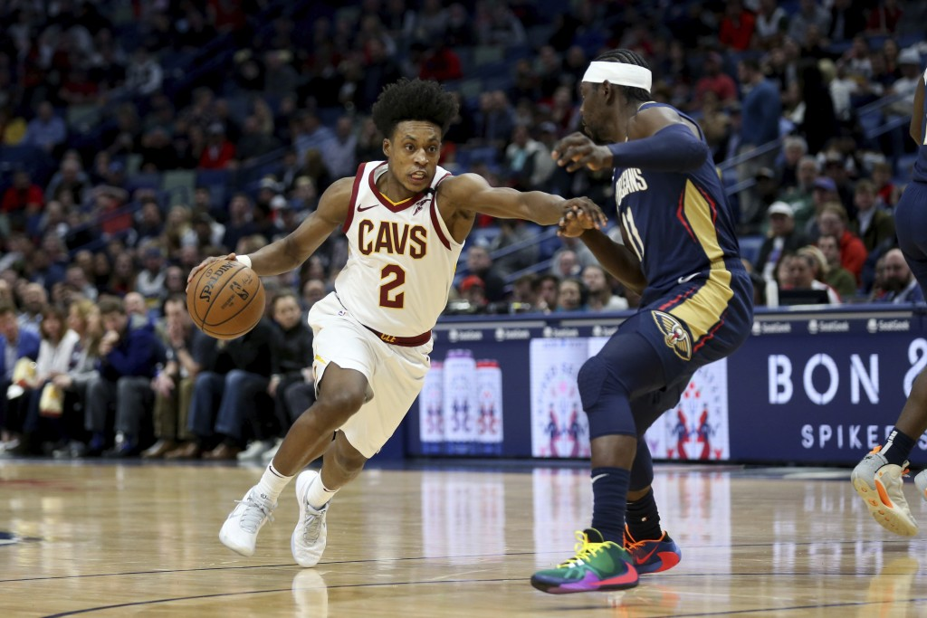 FILE - In this Feb. 28, 2020 file photo, Cleveland Cavaliers guard Collin Sexton (2) drives to the basket as New Orleans Pelicans guard Jrue Holiday (...