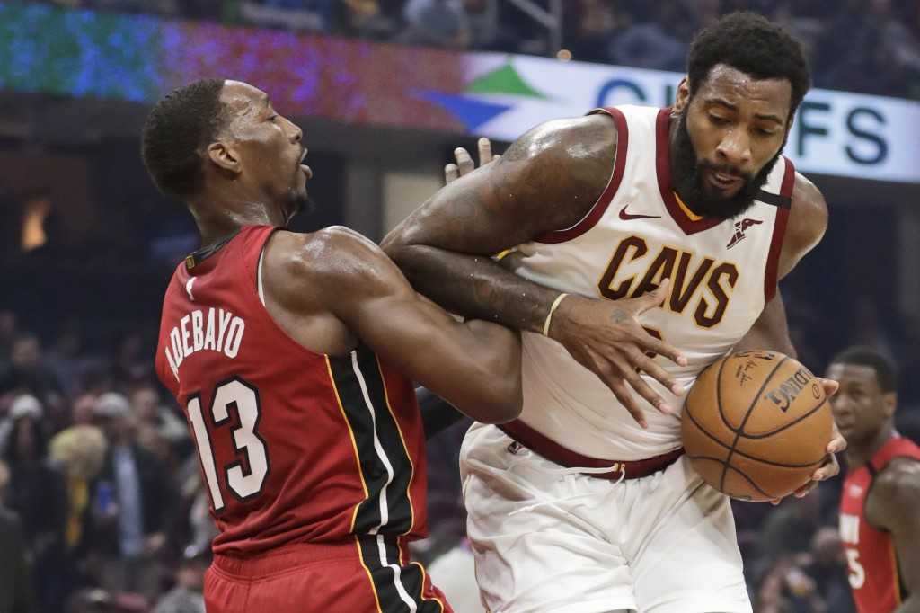 FILE - Cleveland Cavaliers' Andre Drummond, right, drives past Miami Heat's Bam Adebayo in the first half of an NBA basketball game,  in Cleveland.  O...