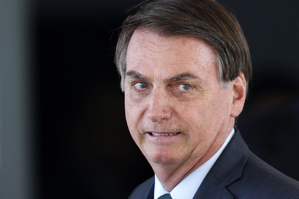 FILE - In this Jan. 7, 2020 file photo, Brazil's President Jair Bolsonaro speaks to journalists after meeting with military commanders at the Defense ...
