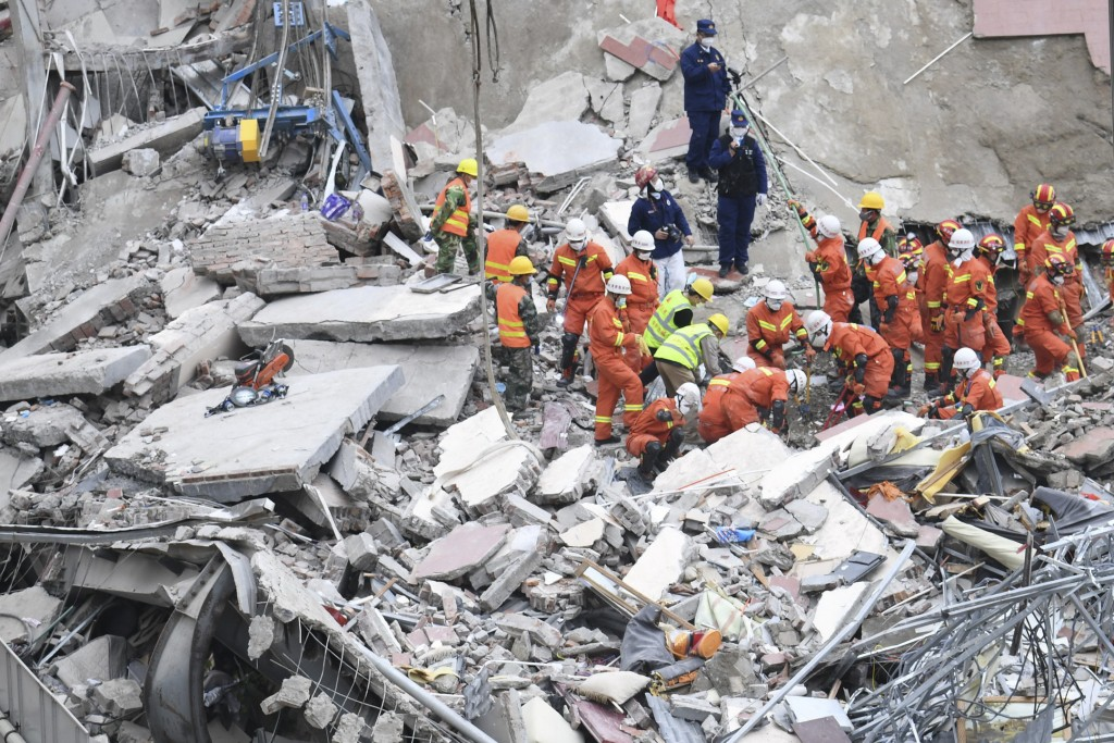 Mother, child found alive in debris over 50 hours after hotel collapse
