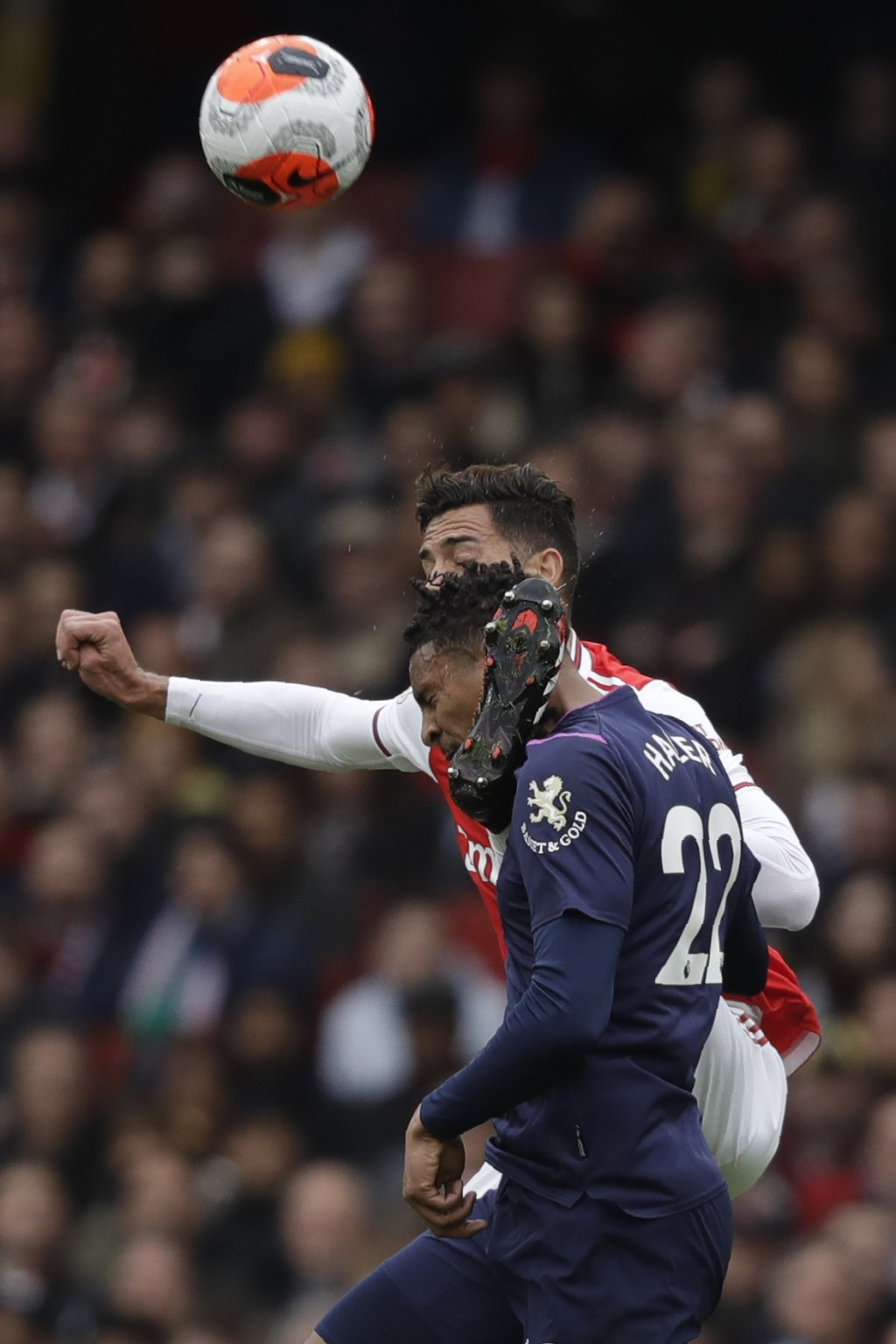Arsenal's Pablo Mari, back, jumps for the ball with West Ham's Sebastien Haller during the Premier League soccer match between Arsenal and West Ham at...