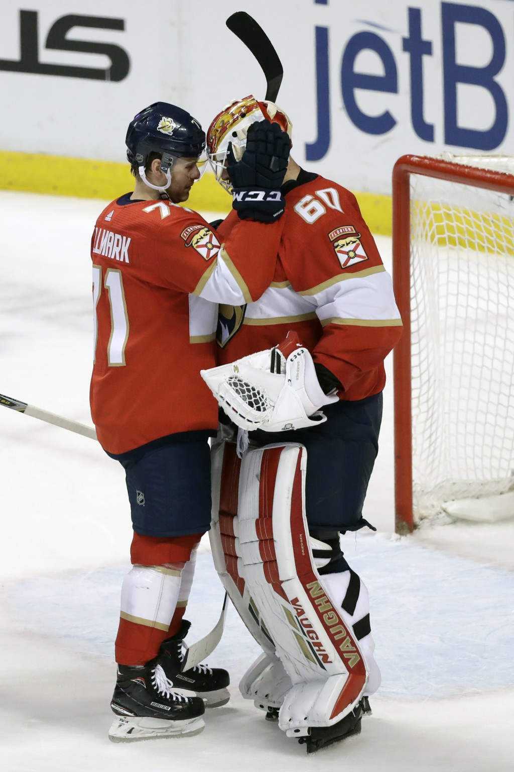 Florida Panthers center Lucas Wallmark (71) congratulates goaltender Chris Driedger (60) after an NHL hockey game against the Montreal Canadiens, Satu...