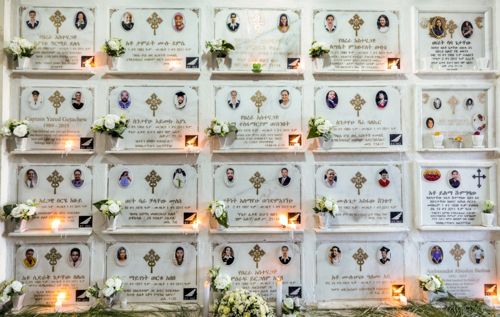 Candles are lit on a memorial wall during an anniversary memorial service to remember those who died when Ethiopian Airlines flight ET302, a Boeing 73...