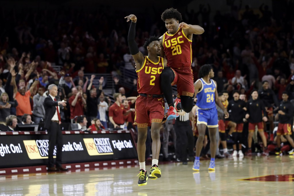 Southern California guard Jonah Mathews (2) celebrates his game-winning 3-point basket with teammate Ethan Anderson (20) in the final seconds of an NC...