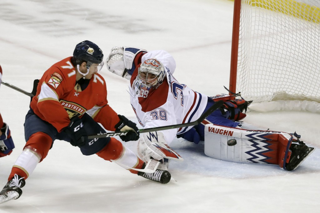 Florida Panthers center Lucas Wallmark (71) scores a goal against Montreal Canadiens goaltender Charlie Lindgren (39) during the second period of an N...