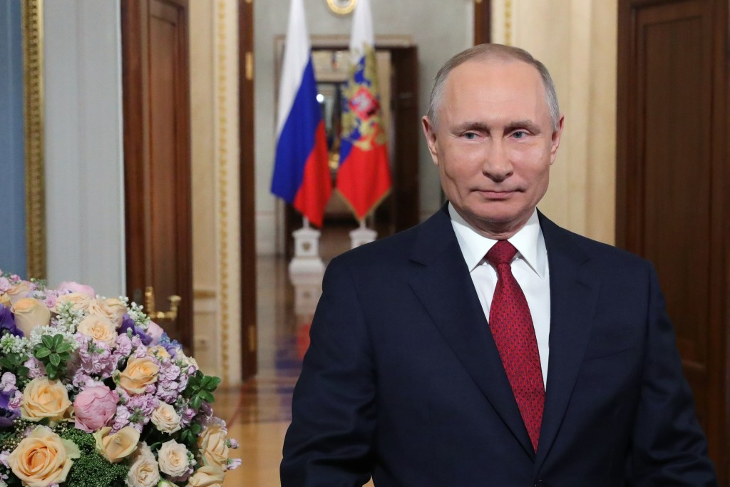 Vladimir Putin backs ex-cosmonaut's plan to extend his stay in power
