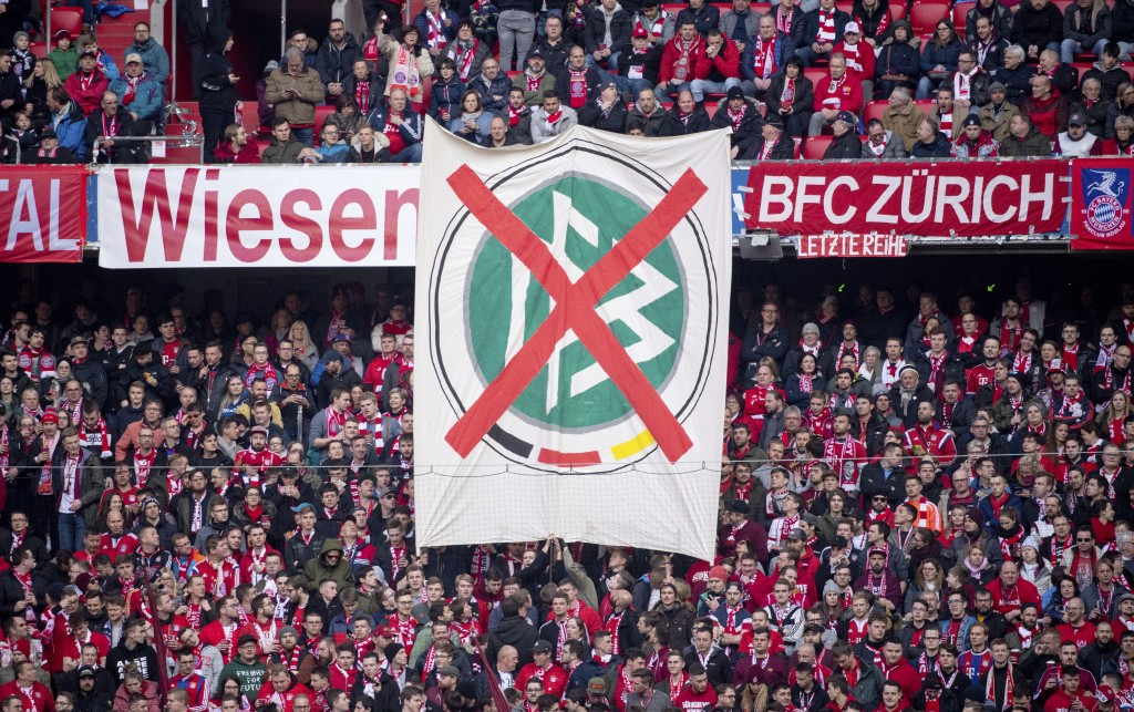 Visitors show a banner with the logo of the German Soccer Association (DFB) during the German Bundesliga soccer match between FC Bayern Munich and FC ...