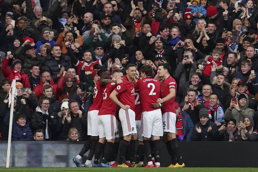 Manchester United's team players celebrate after Anthony Martial scored the opening goal during the English Premier League soccer match between Manche...