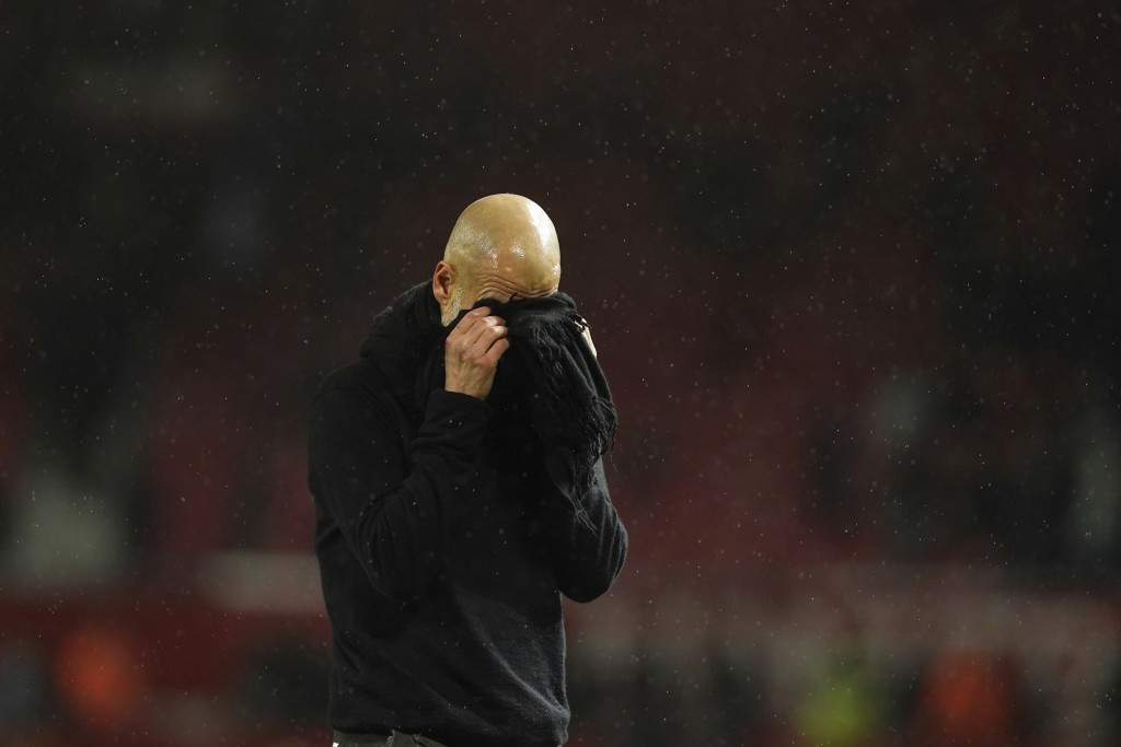 Manchester City's head coach Pep Guardiola reacts after the English Premier League soccer match between Manchester United and Manchester City at Old T...