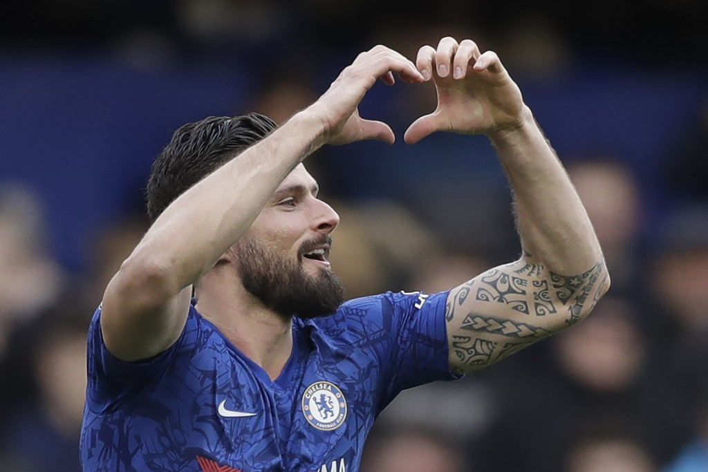 Chelsea's Olivier Giroud celbrates after scoring his side's fourth goal during the English Premier League soccer match between Chelsea and Everton at ...