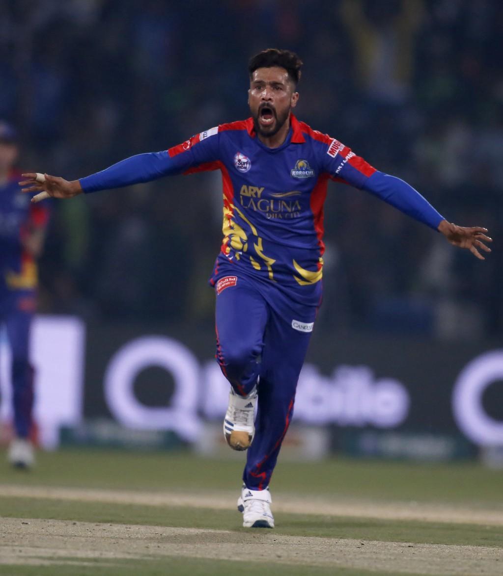 Karachi Kings pacer Mohammad Amir celebrates after taking the wicket of Lahore Qalandars batsman Fakhar Zaman during a Pakistan Super League T20 crick...
