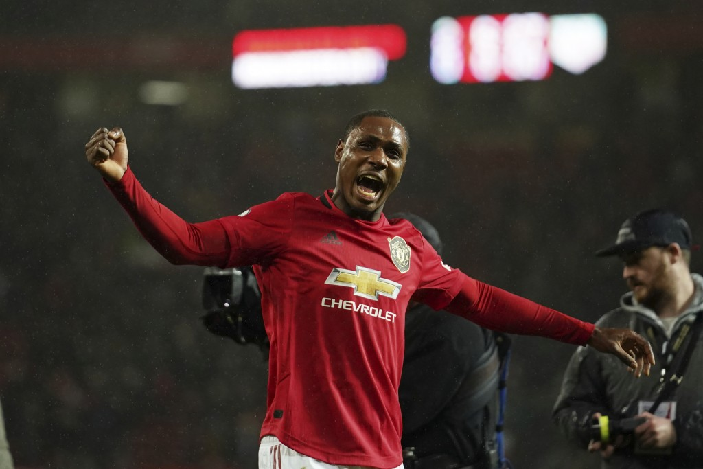 Manchester United's Odion Ighalo celebrates after the English Premier League soccer match between Manchester United and Manchester City at Old Traffor...