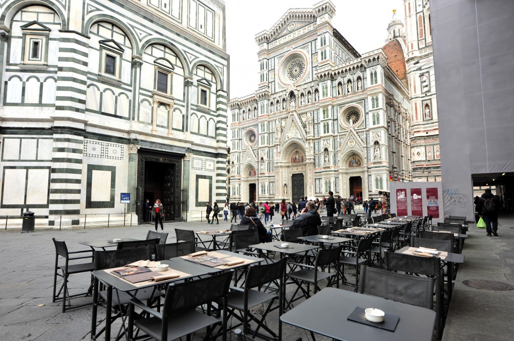 A cafe' is empty in Piazza del Duomo square, in Florence, Italy, Tuesday, March 10, 2020. Italy entered its first day under a nationwide lockdown afte...