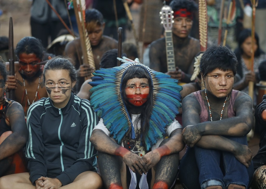 Guarani Mbya indigenous wait for police to enter the property they have been occupying for just over a month in an attempt to stop real estate develop...