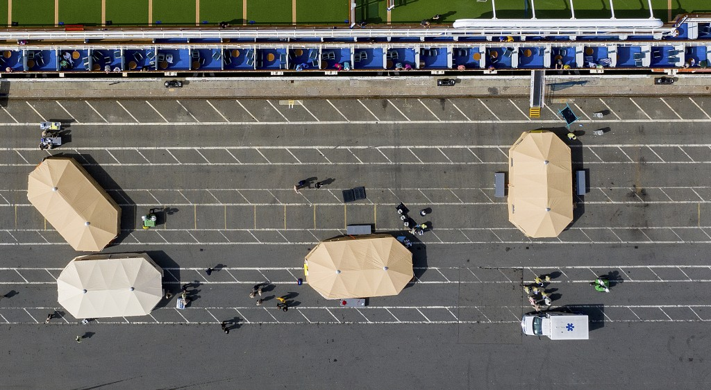 Tents line a wharf as the Grand Princess rests docked, Monday, March 9, 2020, in Oakland, Calif. The cruise ship, which had maintained a holding patte...