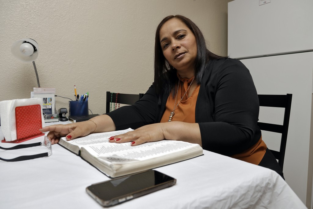 In this Wednesday, Feb. 26, 2020 photo, Yarelis Gutierrez Barrios poses for a photo at her home in Tampa, Fla. Her partner Roylan Hernandez Diaz, a Cu...
