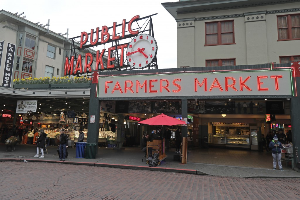 In this March 6, 2020 photo, the area near Pike Place Fish Market at the Pike Place Market in Seattle is nearly devoid of root traffic and crowds at t...