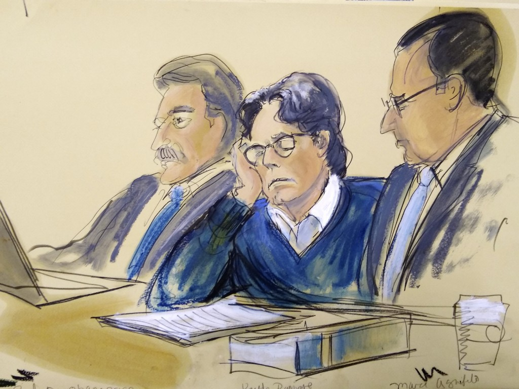 FILE - In this June 18, 2019 courtroom artist's sketch, defendant Keith Raniere, center, sits with attorneys Paul DerOhannesian, left, and Marc Agnifi...